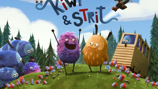 Two round, furry characters with stick legs standing on a green field surrounded by other furry characters and trees in the background.